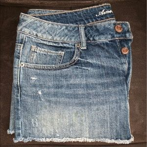 TWO American Eagle distressed mini skirts size 12